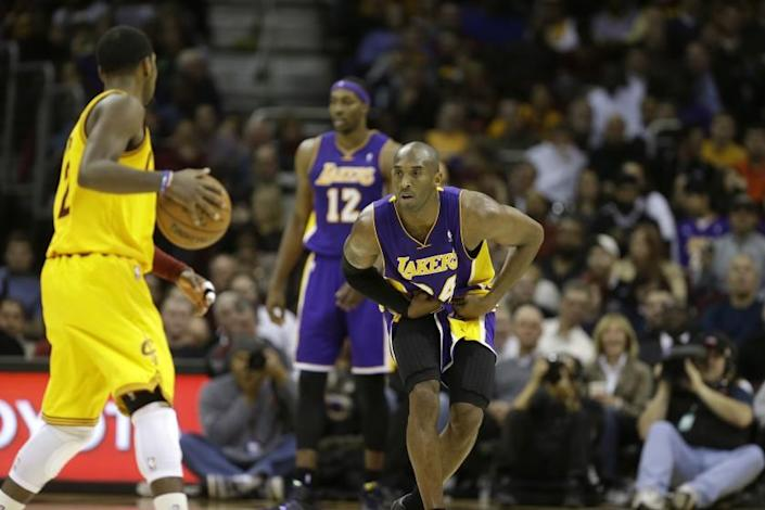 Lakers' Kobe Bryant defends against Cleveland Cavaliers' Kyrie Irving on Dec. 11, 2012.