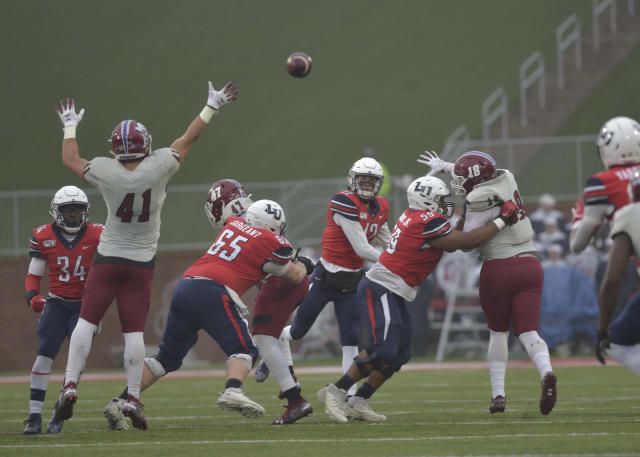 Liberty quarterback Buckshot Calvert throws the ball during an NCAA college football game against New Mexico State in Lynchburg, Va., on Saturday, Nov. 30, 2019. (Taylor Irby/ News & Advance via AP)