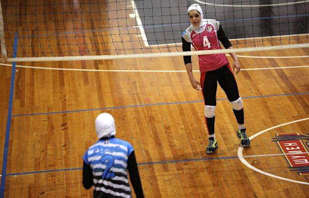 "Iranian volleyball players Maedeh Borhani (R) and Zeinab Giveh chat during a training session of ""Shumen"" volleyball club in Shumen, Bulgaria January 14, 2017. Picture taken on January 14, 2017. REUTERS/Stoyan Nenov"