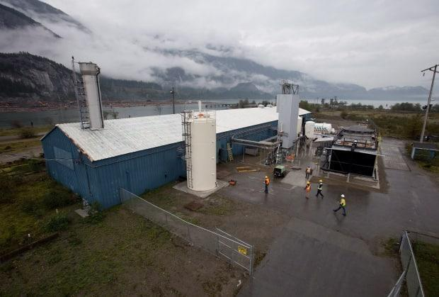 Workers at Calgary-based Carbon Engineering's first direct air capture plant in Squamish, B.C., in 2015. The plant removes carbon dioxide directly from atmospheric air. Countries are counting on carbon removal to balance off emissions that are hard to eliminate and achieve net zero. (Darryl Dyck/The Canadian Press - image credit)