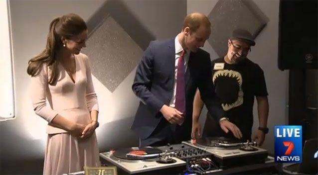 Prince William gets a crash course lesson in using the turntables at Northern Sound System. Photo: 7News.