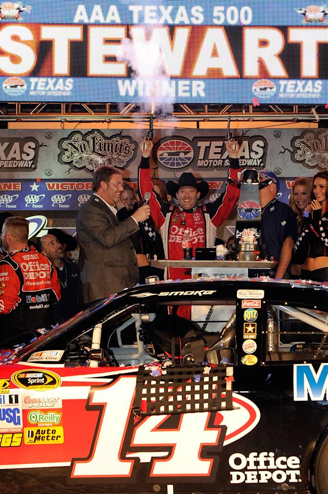 FORT WORTH, TX - NOVEMBER 06:  Texas Motor Speedway president Eddie Gossage (L) poses with Tony Stewart, driver of the #14 Office Depot/Mobil 1 Chevrolet, in Victory Lane after winning the NASCAR Sprint Cup Series AAA Texas 500 at Texas Motor Speedway on November 6, 2011 in Fort Worth, Texas.  (Photo by John Harrelson/Getty Images for NASCAR)