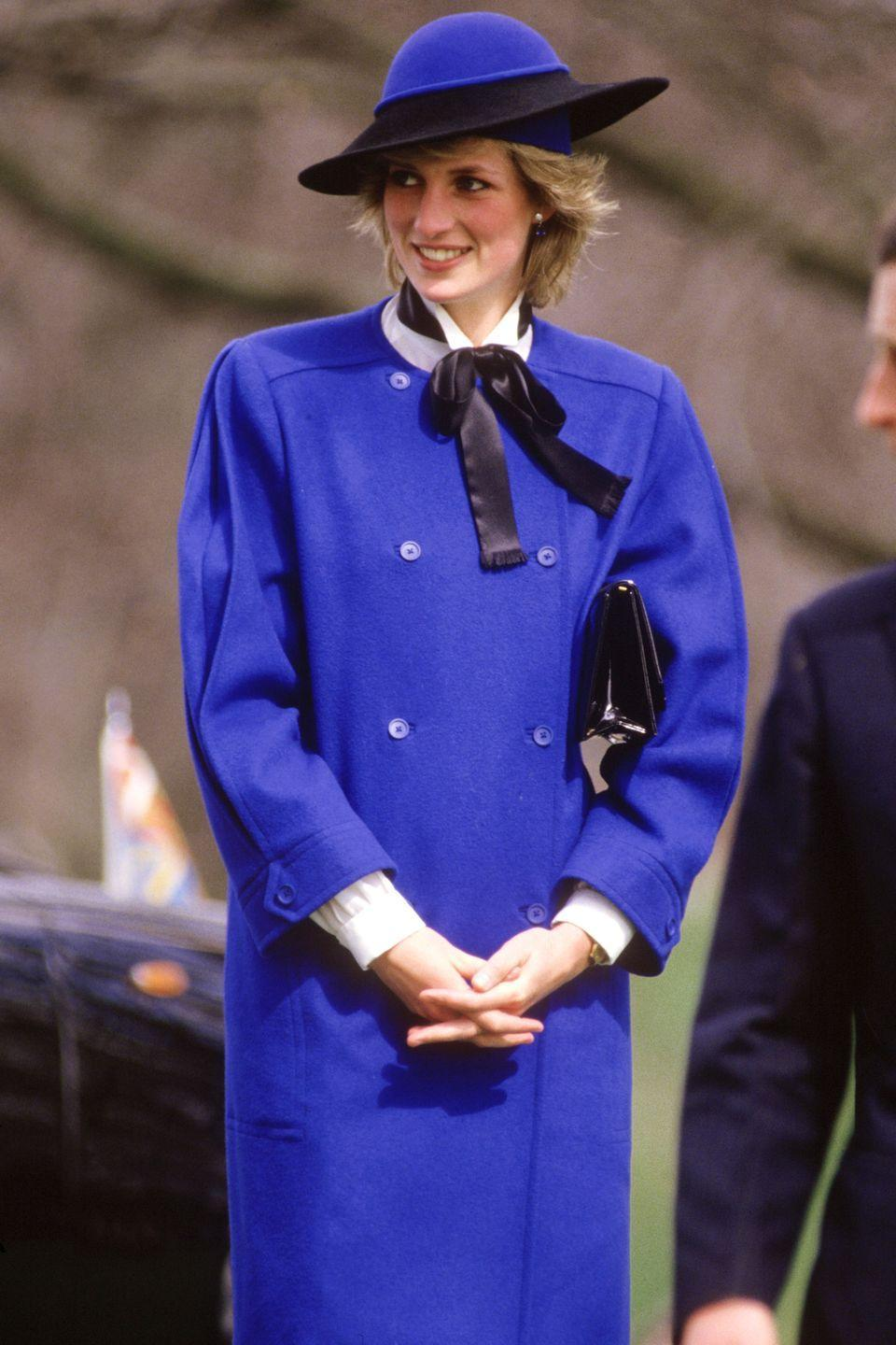 <p>In a blue coat by Bellville Sassoon with matching hat and a patent-leather clutch while visiting Hereford Cathedral. </p>