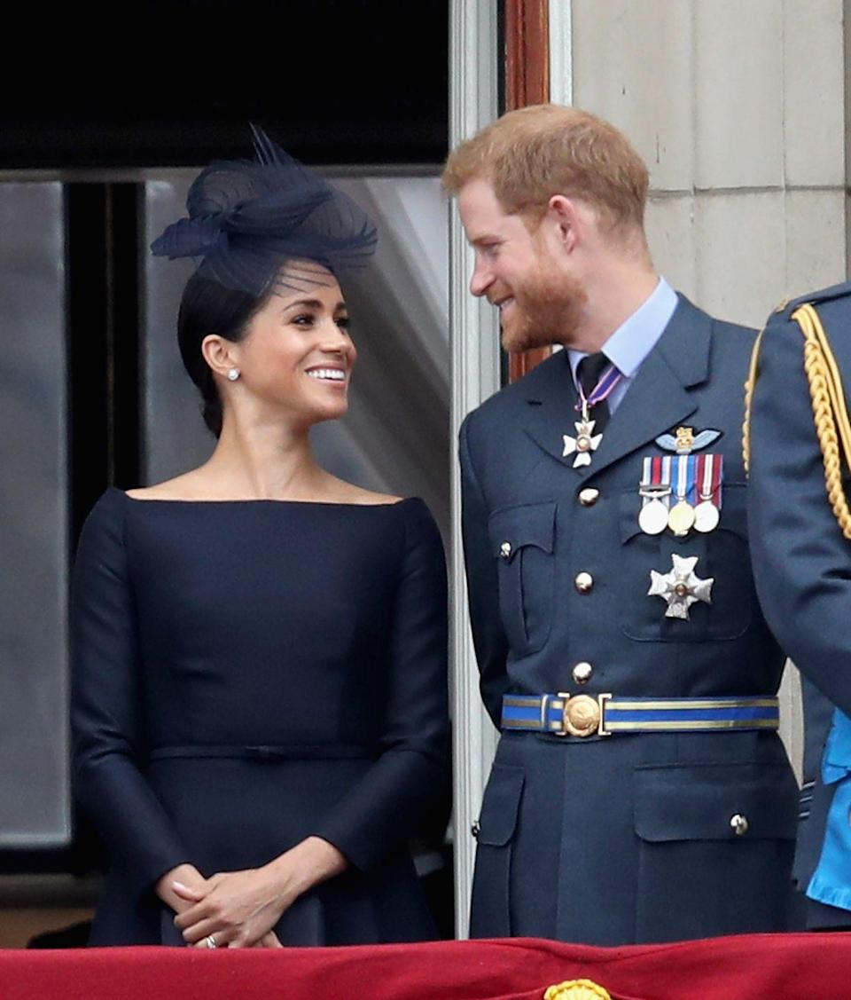 <p>Standing alongside the Royal Family in July 2018, the couple gazed lovingly into each other's eyes and proved love will never die. </p>