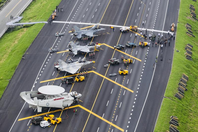 In this photo released by Military News Agency, Taiwan war planes are parked on a highway during an exercise to simulate a response to a Chinese attack on its airfields in Changhua in southern Taiwan. Tuesday's exercise is part of annual drills designed to showcase the island's military capabilities and resolve to repel an attack from across the Taiwan Strait amid perceptions of a rising threat. (Military News Agency via AP)