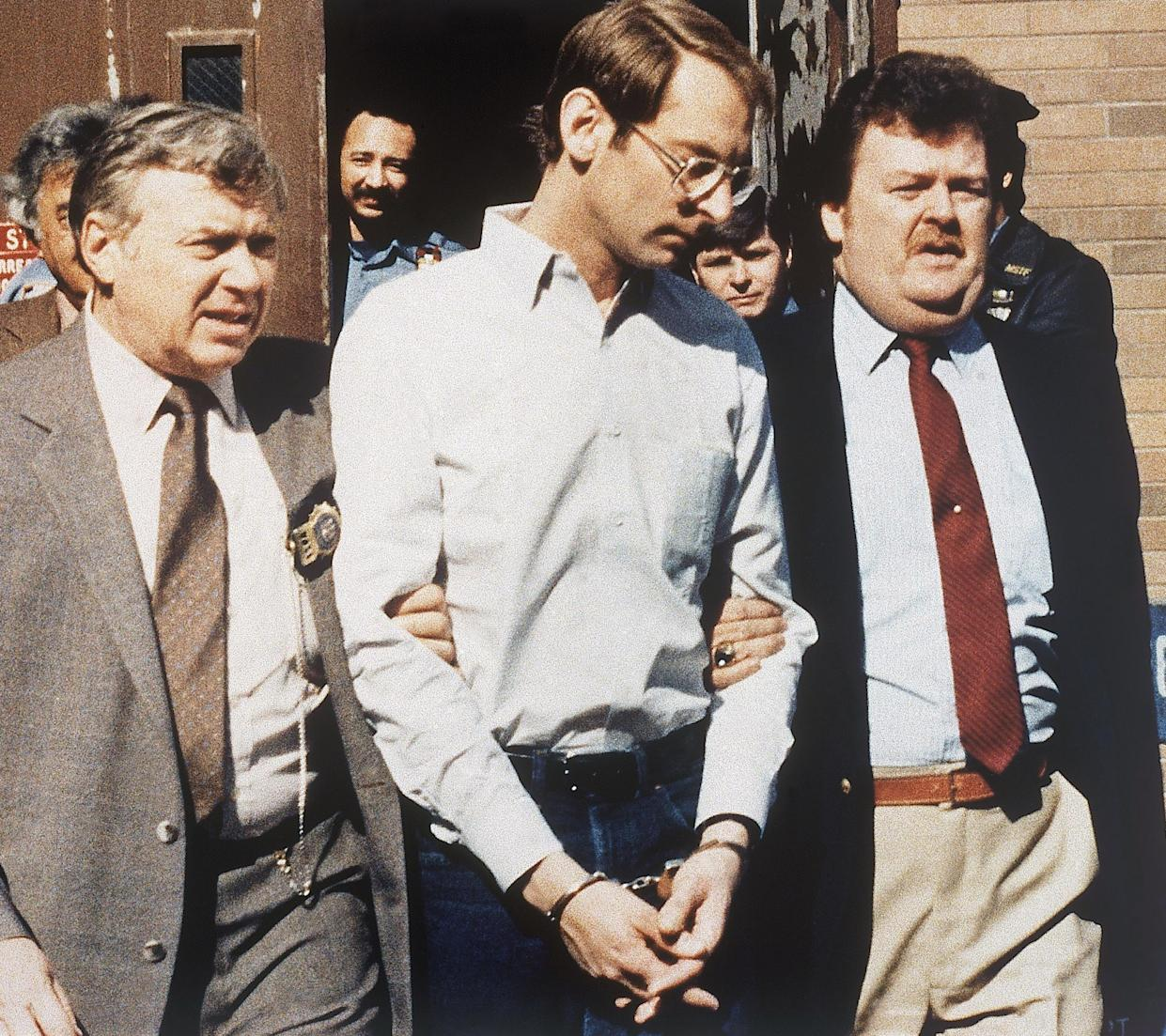 Bernard Goetz is escorted to his arraignment in New York in 1985, to be charged in the subway shootings of four youths.
