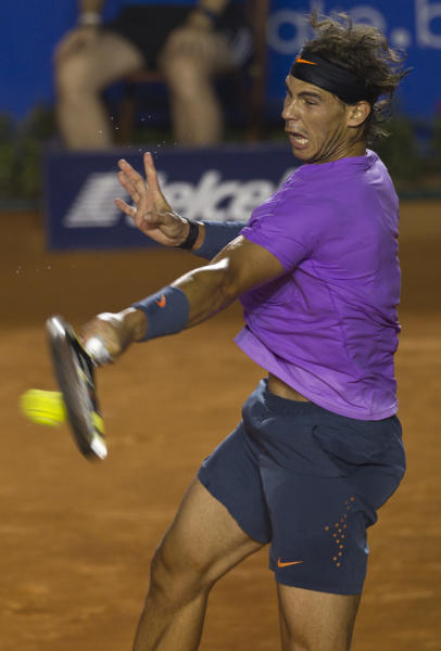 Spain´s Rafael Nadal returns the ball to Spain´s David Ferrer during the final round match at the Mexico Open tennis tournament in Acapulco, Mexico, Saturday, March 2, 2013. (AP Photo/Christian Palma)