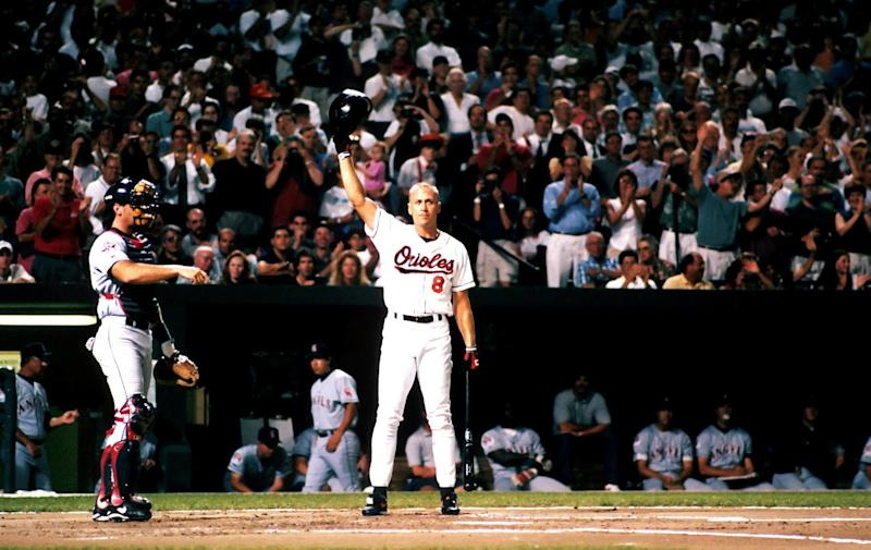 BALTIMORE - SEPTEMBER 6: Infielder Cal Ripken Jr. of the Baltimore Orioles tips his batting helmet to the fans after breaking Lou Gherig's record of 2130 consecutive games played on September 6, 1995 at Oriole Park at Camden Yards in Baltimore, Maryland. (Photo by Bryan Yablonsky/Sportschrome/Getty Images)