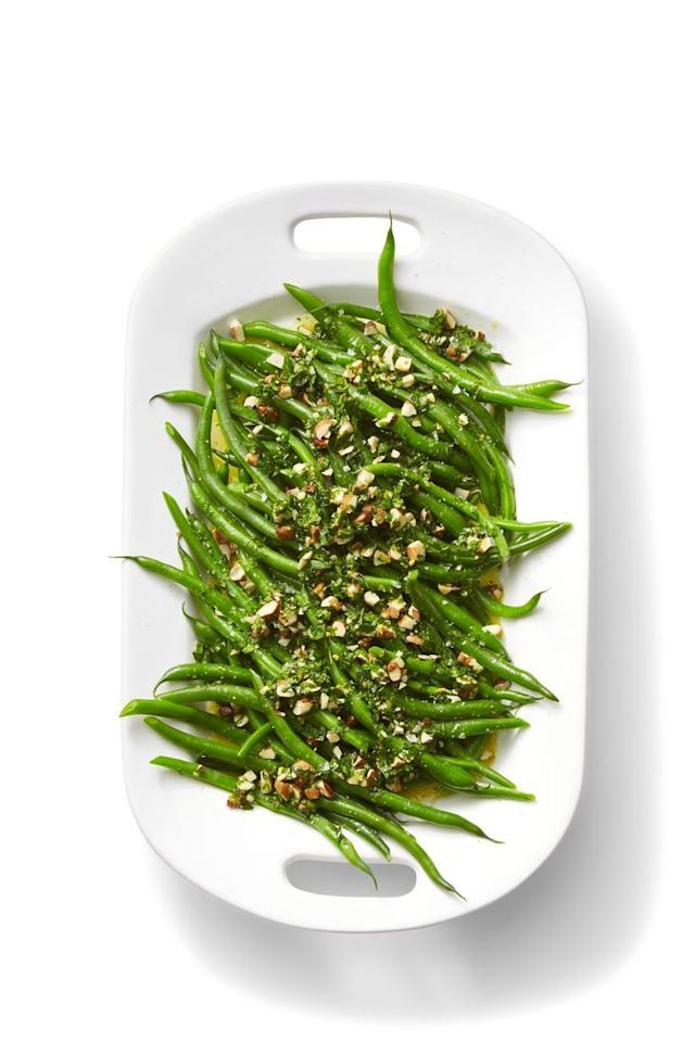 """<p>Add an extra crunch to your green beans with some chopped up almonds.</p><p><em><a href=""""https://www.womansday.com/food-recipes/food-drinks/a24115941/green-beans-with-orange-and-almond-gremolata-recipe/"""" target=""""_blank"""">Get the recipe for <em></em>Green Beans with Orange and Almond Gremolata.</a></em></p>"""