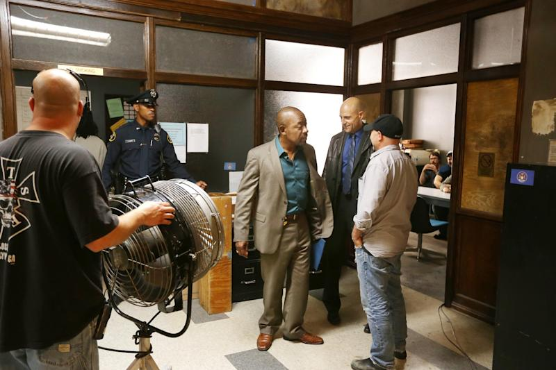 """In this May 20, 2013, photo, actors Lennie James, center, and Mark Strong, second from right, talk with director Andrew Bernstein, right, during a break in the filming of """"Low Winter Sun"""" in Detroit. The series, premiering Sunday, Aug. 11, revives a two-part U.K. miniseries from 2006. It also marks Hollywood's return to the Motor City as a place to explore crime, following ABC's """"Detroit 1-8-7."""" It aired during the 2010-11 season. (AP Photo/Carlos Osorio)"""