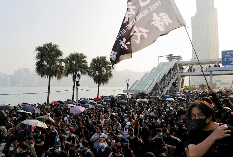 Hong Kong protesters march against use of tear gas after week of calm
