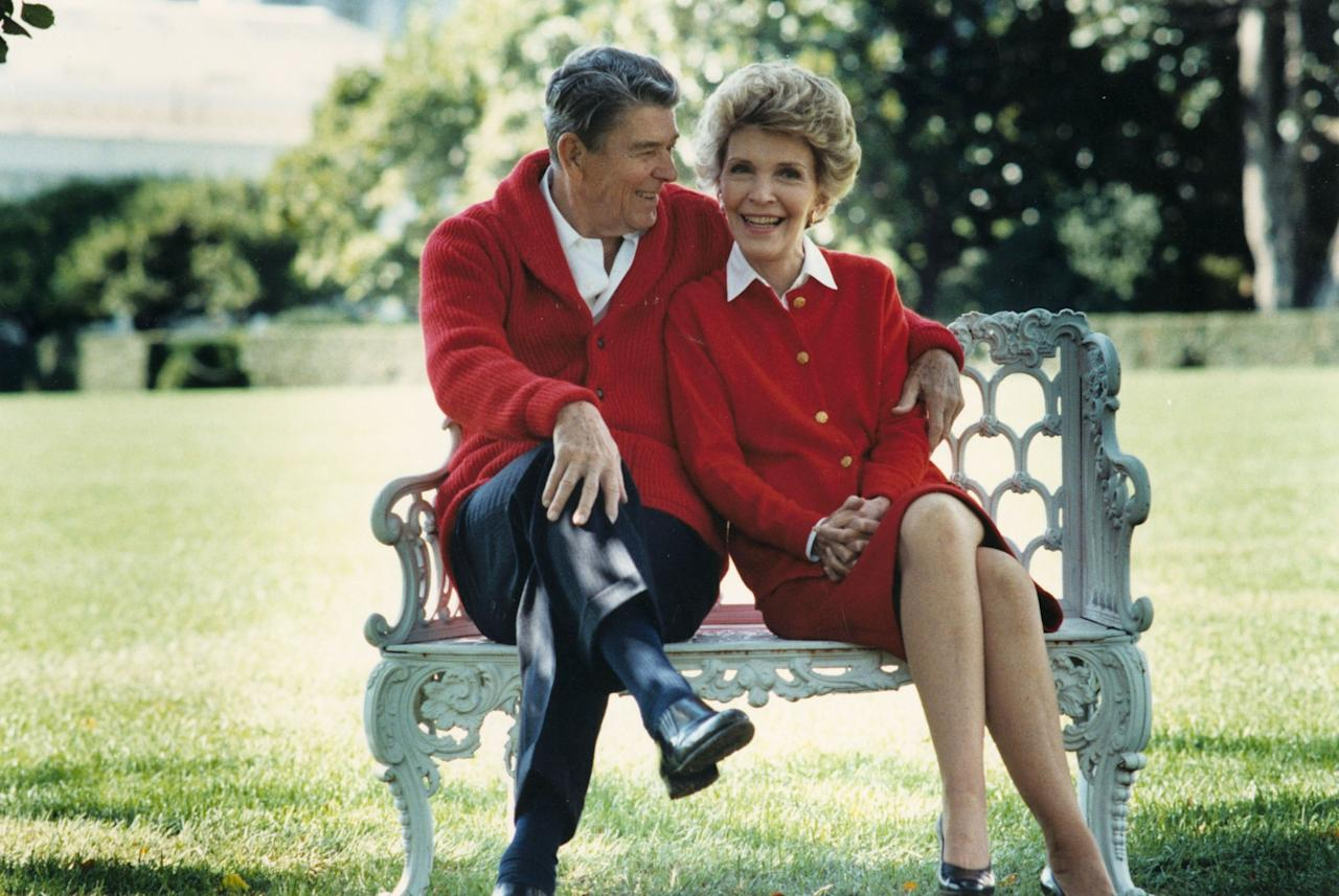 """<p>It was the 1980s — a time for extravagant fashion and fluffy hair. First Lady Nancy Reagan certainly didn't disappoint! She dressed patriotically and was a huge fan of the colour red. In an interview with <i>W Magazine</i>, the First Lady was quoted as saying """"I always liked red. It's a picker-upper."""" <i> (Photo courtesy of the Ronald Reagan Presidential Library/Getty Images) </i> </p>"""
