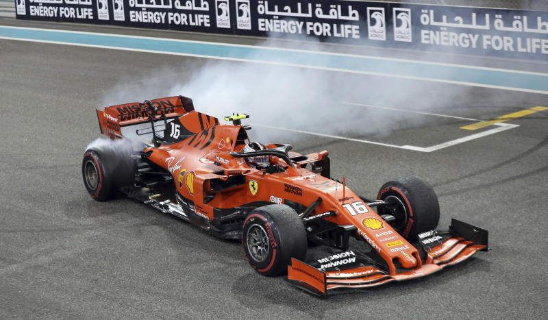Ferrari driver Charles Leclerc of Monaco celebrates at finish line after he placed third in the Emirates Formula One Grand Prix, at the Yas Marina racetrack in Abu Dhabi, United Arab Emirates, Sunday, Dec.1, 2019. (AP Photo/Luca Bruno)
