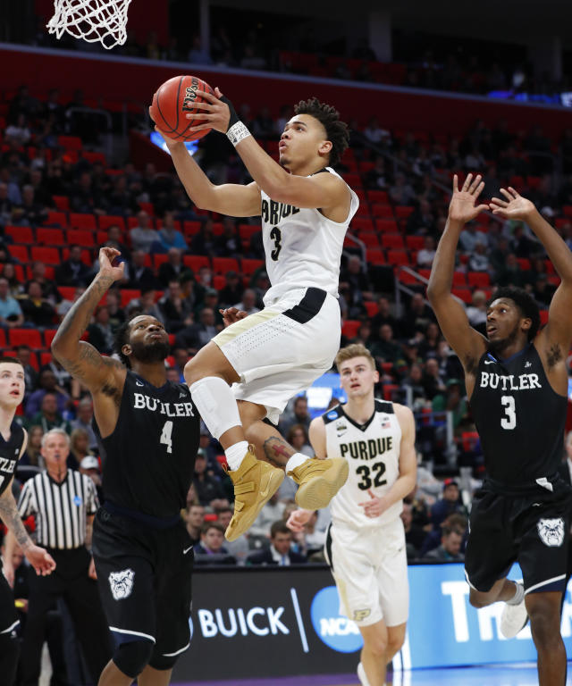 Purdue guard Carsen Edwards (3) drives the basket against Butler during the second half of an NCAA men's college basketball tournament second-round game in Detroit, Sunday, March 18, 2018. (AP Photo/Paul Sancya)