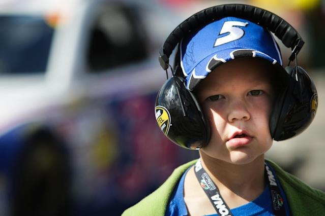 Josh Adams, 7, of Dover, Del., sports a signed hat of his favorite racer, Kasey Kahne, at the NASCAR Sprint Cup Series auto race Sunday, Sept. 29, 2013, in Dover, Del. (AP Photo/The News-Journal, Suchat Pederson)