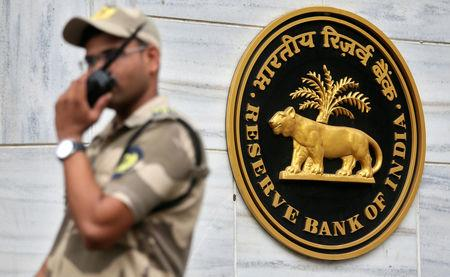A guard stands next to the Reserve Bank of India (RBI) logo outside its headquarters in Mumbai, India, October 5, 2018. REUTERS/Francis Mascarenhas
