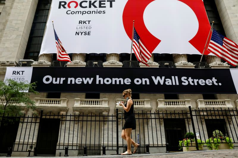 FILE PHOTO: FILE PHOTO: A banner celebrating Rocket Companies Inc. IPO is seen on the front facade of the NYSE in New York