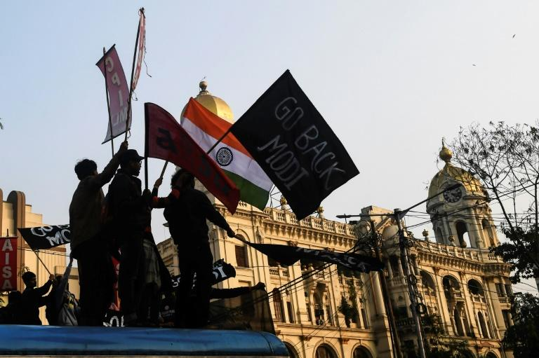 Activists held placards, waved flags and shouted slogans against Modi and the new citizenship law during the Kolkata demonstration (AFP Photo/Dibyangshu SARKAR)