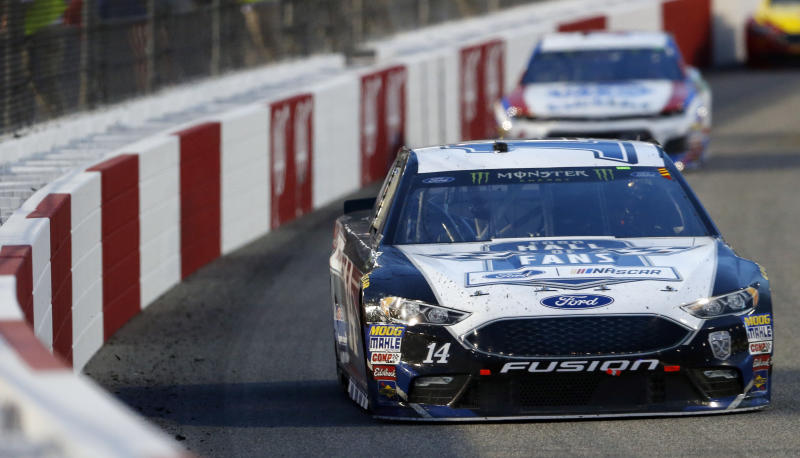Larson takes pole at Dover International