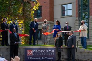 General (Ret.) John F. Kelly, a former White House Chief of Staff and Secretary of Homeland Security, cuts the ribbon to Burlington Capital's Victory II Apartments in Omaha, a 60-unit apartment complex that provides housing and health, wellness and job training services to homeless veterans.