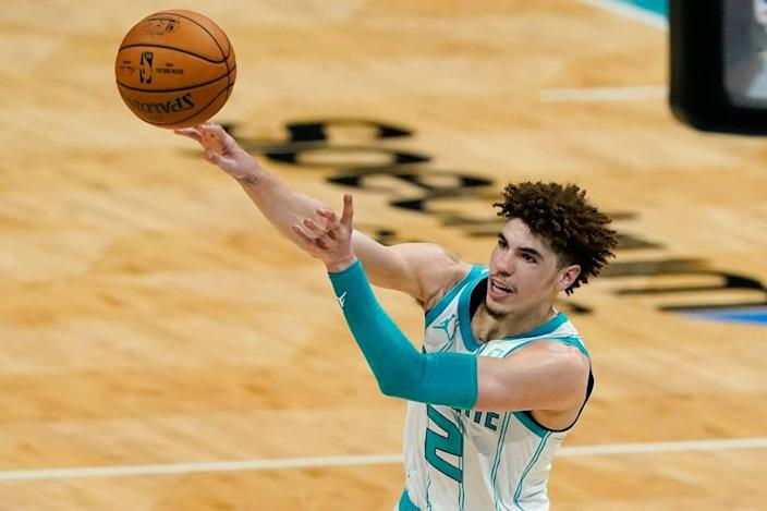 Charlotte Hornets guard LaMelo Ball passes against the Miami Heat Sunday. Ball had five assists but also five turnovers in Miami's 121-111 win.