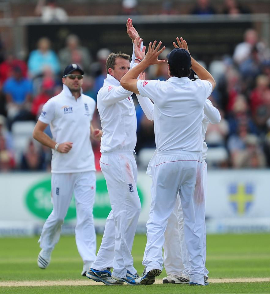 England's Graeme Swann celebrates with his team-mates after taking the wicket of Australia's Chris Rogers during day four of the Fourth Investec Ashes test match at the Emirates Durham ICG, Durham.