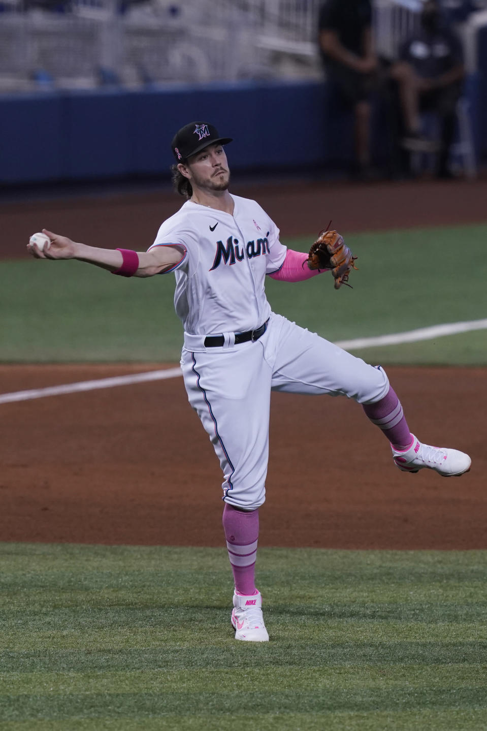 Miami Marlins third baseman Brian Anderson throws to first base on a hit by Milwaukee Brewers' Luis Urias, during the fourth inning of a baseball game, Sunday, May 9, 2021, in Miami. (AP Photo/Marta Lavandier)
