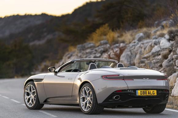 A silver Aston Martin DB11 Volante, a sleek luxury-sports convertible, shown from a rear three-quarter view.