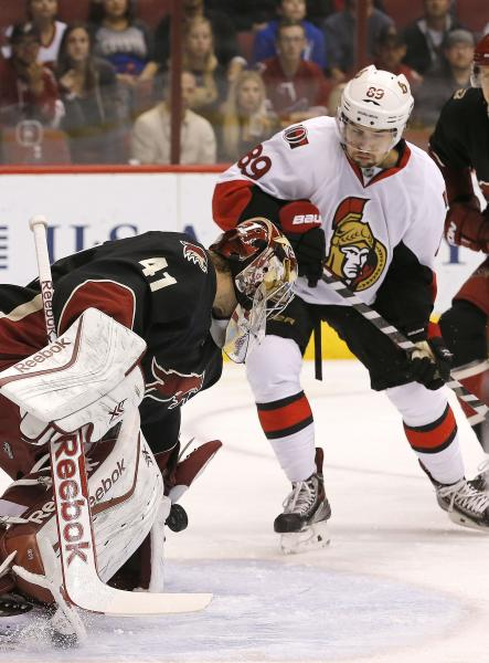 Phoenix Coyotes' Mike Smith (41) makes a save on a shot by by Ottawa Senators' Cory Conacher (89) during the first period in an NHL hockey game Tuesday, Oct. 15, 2013, in Glendale, Ariz. (AP Photo/Ross D. Franklin)