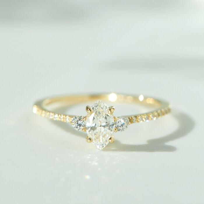 """<p>The <a href=""""https://www.popsugar.com/buy/Coralie-Solitaire-Ring-531771?p_name=Coralie%20Solitaire%20Ring&retailer=catbirdnyc.com&pid=531771&price=5%2C200&evar1=fab%3Aus&evar9=47015200&evar98=https%3A%2F%2Fwww.popsugar.com%2Ffashion%2Fphoto-gallery%2F47015200%2Fimage%2F47015976%2FThin-Bands-Coralie-Solitaire-Ring&list1=shopping%2Cjewelry%2Crings%2Cengagement%20rings&prop13=mobile&pdata=1"""" rel=""""nofollow noopener"""" class=""""link rapid-noclick-resp"""" target=""""_blank"""" data-ylk=""""slk:Coralie Solitaire Ring"""">Coralie Solitaire Ring</a> ($5,200) is exquisite in every way. Even with the small band, the diamonds are still able to be seen on each side of the large stone.</p>"""