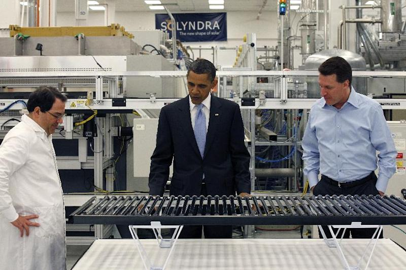 FILE - In this May 26, 2010 file photo, President Barack Obama, accompanied by Solyndra Chief Executive Officer Chris Gronet, right, and Executive Vice President Ben Bierman, left, looks at a solar panel during a tour of Solyndra, Inc., a solar panel manufacturing facility, in Fremont, Calif. Mitt Romney mischaracterized an Energy Department Inspector General investigation when he claimed it found the Obama administration had steered federal contracts to friends and family at Solyndra, the California solar company that went bankrupt. (AP Photo/Alex Brandon, File)