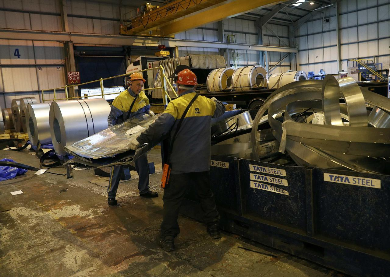 Workers move waste metal at Tata Steel's new robotic welding line at their Automotive Service Centre in Wednesfield, Britain, February 15, 2017. REUTERS/Darren Staples