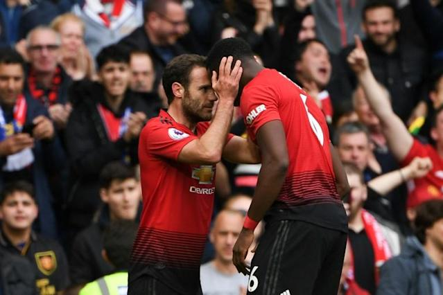 Positive Pogba: Juan Mata (left) believes Paul Pogba (right) remains a positive influence for Manchester United (AFP Photo/Paul ELLIS)