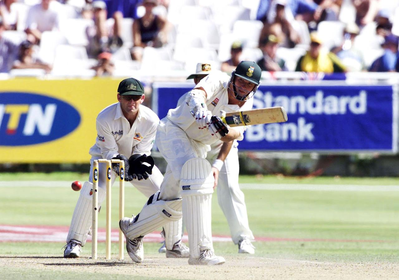 10 Mar 2002: Graeme Smith plays a shot as Adam Gilchrist looks on during the third day of the second test match between South Africa and Australia held at Newlands.  DIGITAL IMAGE.  Touchline Photo images are available to clients in the UK, USA, and Australia only. Mandatory Credit: Touchline Photo/Getty Images