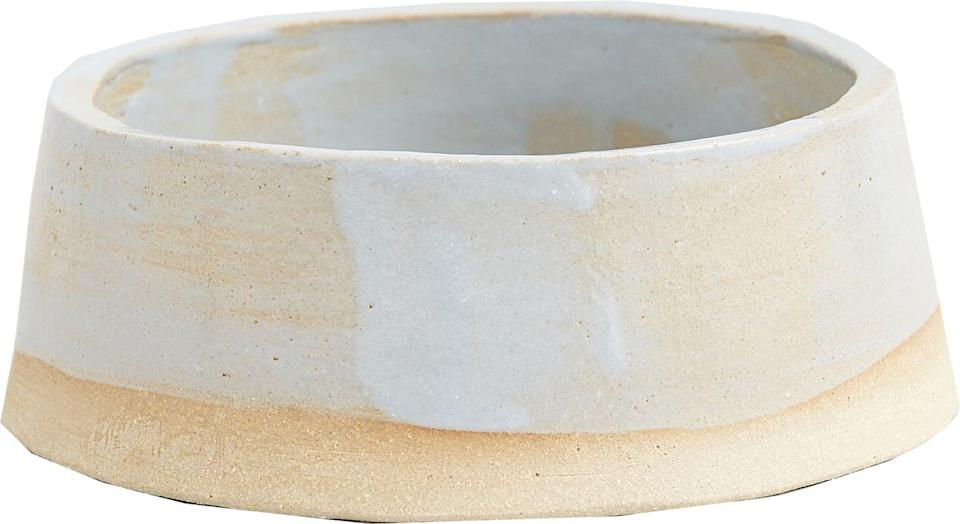 """<p>This artful ceramic bowl, made in collaboration with Kana London, will elevate doggy dining to the highest echelons. With its sea-blue hues, it is designed to evoke early-morning walks on the Cornish coast. </p><p>£48, <a href=""""https://kintails.com/collections/at-home/products/fetch-and-follow-x-kana-sunrise-dog-bowls"""" rel=""""nofollow noopener"""" target=""""_blank"""" data-ylk=""""slk:Kintails x Kana London"""" class=""""link rapid-noclick-resp"""">Kintails x Kana London</a>.</p>"""
