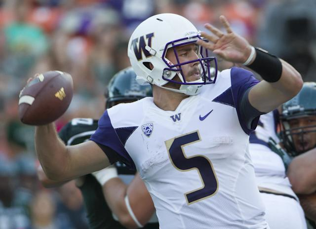 Washington quarterback Jeff Lindquist drops back to pass in the third quarter of an NCAA college football game against Hawaii, Saturday, Aug. 30, 2014, in Honolulu. (AP Photo/Eugene Tanner)