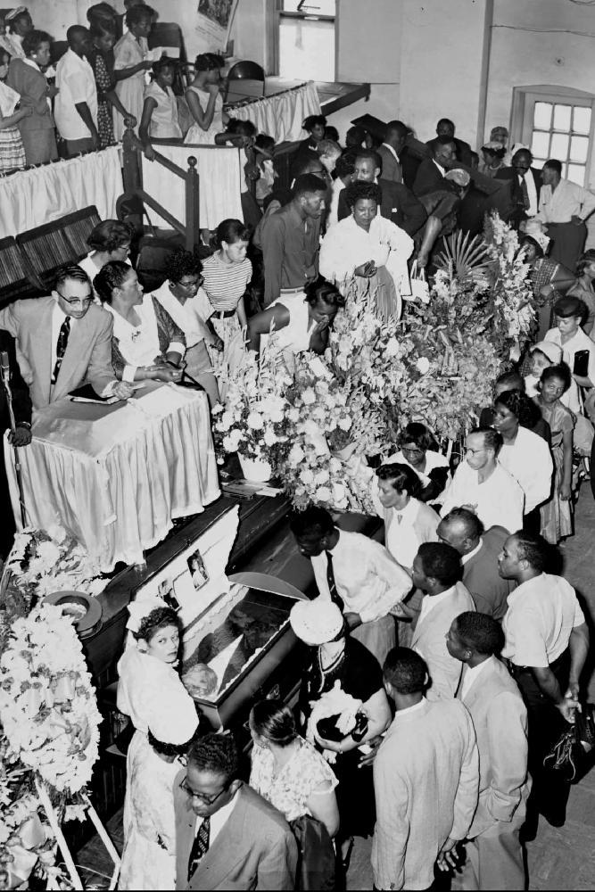 In this Sept. 3, 1955, file photo, mourners pass Emmett Till's casket in Chicago. Till was a 14-year-old African American boy who was kidnapped, tortured and lynched for whistling at a white woman in Mississippi by a white mob.