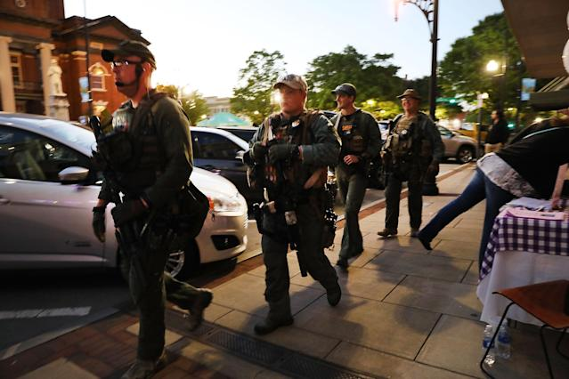 <p>Police patrol the streets of Newnan the night before the National Socialist Movement, one of the largest neo-Nazi groups in the U.S., plans to hold a rally in downtown on April 20, 2018 in Newnan, Ga. (Photo: Spencer Platt/Getty Images) </p>