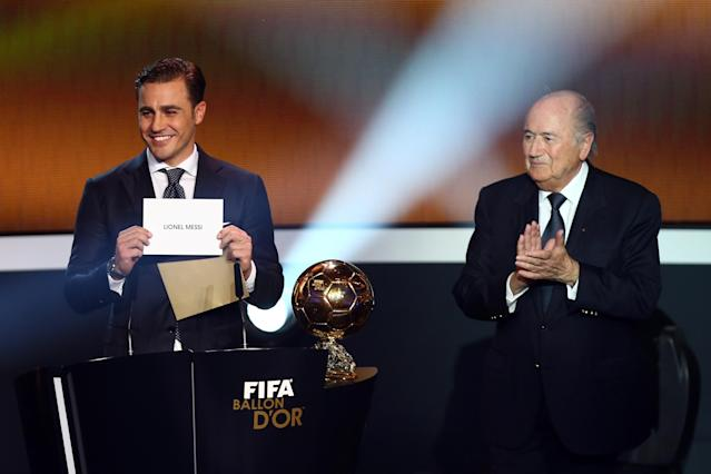 ZURICH, SWITZERLAND - JANUARY 07: Fabio Cannavaro (L) and Joseph Blatter, FIFA president (R) announce Lionel Messi of Argentina as the winner of the FIFA Ballon d'Or 2012 trophy on January 7, 2013 in Zurich, Switzerland. (Photo by Christof Koepsel/Getty Images)