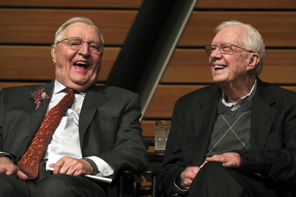 FILE - In this Saturday, Jan. 13, 2018, file photo, former Vice President Walter Mondale, left, sits onstage with former President Jimmy Carter during a celebration of Mondale's 90th birthday at the McNamara Alumni Center on the University of Minnesota's campus, in Minneapolis. Mondale, a liberal icon who lost the most lopsided presidential election after bluntly telling voters to expect a tax increase if he won, died Monday, April 19, 2021. He was 93. (Anthony Souffle/Star Tribune via AP, File)