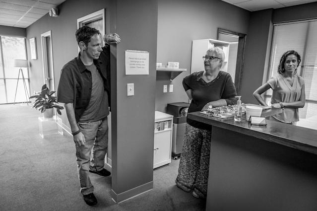 <p>Jack Barrett speaks with counsellors. Barrett credits Groups with saving his life. To pass the gift on, he distributes pamphlets for Groups around his neighborhood, and tries to recruit friends to join him in treatment. (Photograph by Mary F. Calvert for Yahoo News) </p>