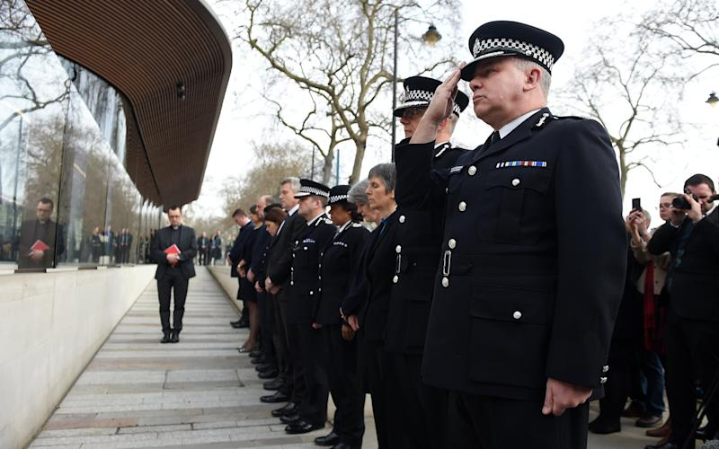 Metropolitan Police Service Acting Commissioner Craig Mackey salutes during a one minutes silence for their fallen officer, Pc Keith Palmer, outside New Scotland Yard in London -  EPA/ANDY RAIN