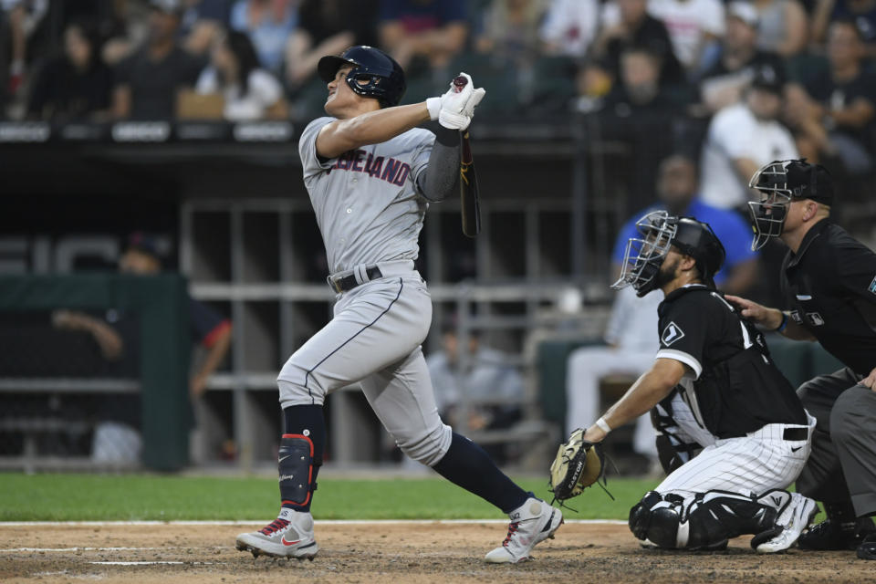 Cleveland Indians' Yu Chang watches his two-run triple during the sixth inning of the team's baseball game against the Chicago White Sox on Saturday, July 31, 2021, in Chicago. (AP Photo/Paul Beaty)
