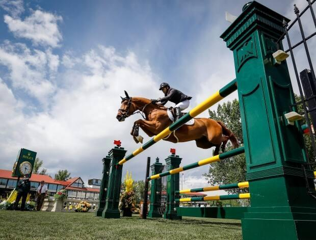 In this file photo, the Grand Prix event of the National at Spruce Meadows in Calgary take place in 2019. (Jeff McIntosh/The Canadian Press - image credit)