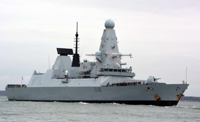 Russian forces fire warning shots at Royal Navy destroyer