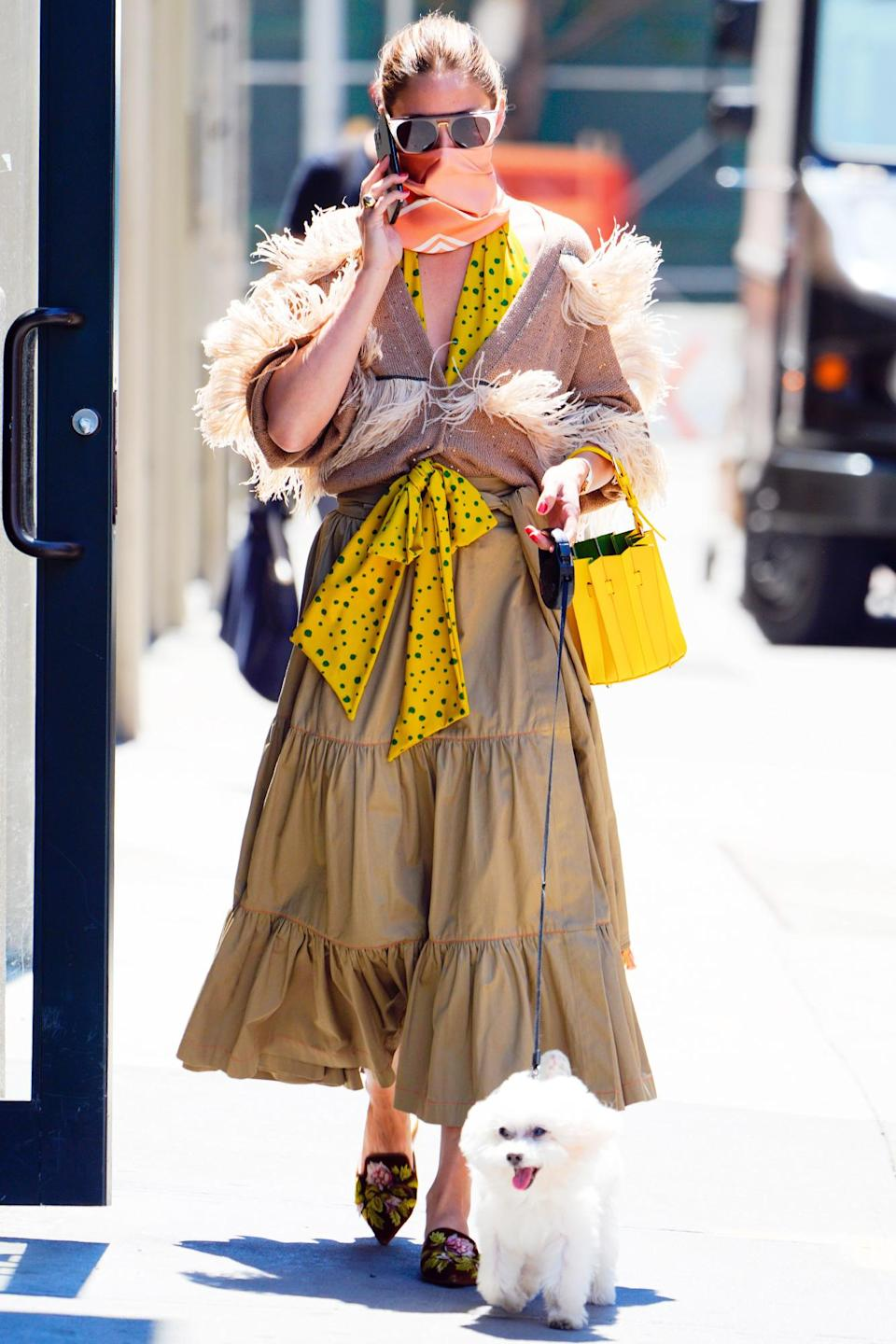 <p>Olivia Palermo rocks a boho maxi dress while walking her dog, Mr. Butler, in N.Y.C. on Monday. </p>