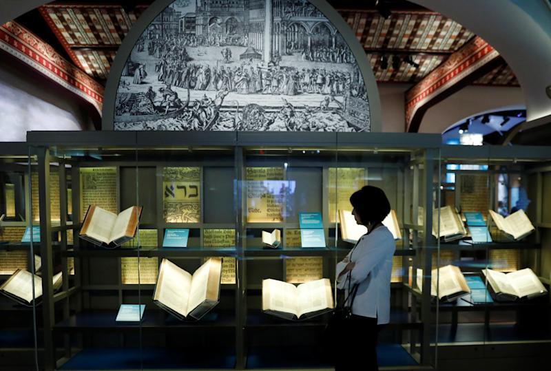 A visitor looks at various Bibles during a preview at the Museum of the Bible on Nov.14. (Kevin Lamarque/Reuters)