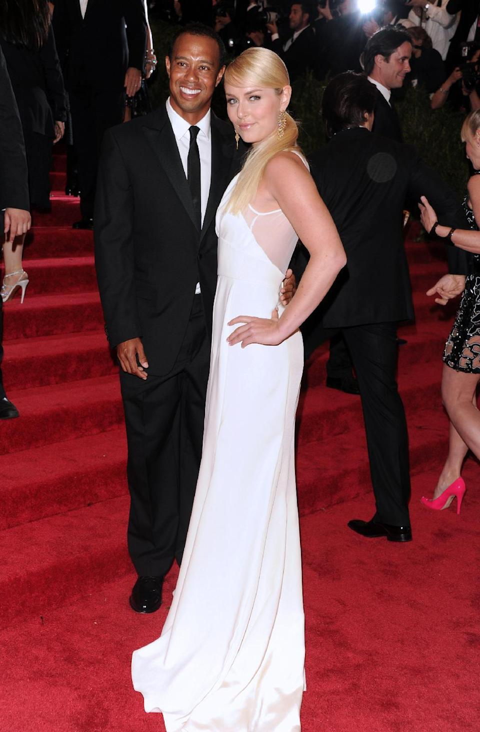 """Golfer Tiger Woods and skier Lindsey Vonn attend The Metropolitan Museum of Art's Costume Institute benefit celebrating """"PUNK: Chaos to Couture"""" on Monday May 6, 2013 in New York. (Photo by Evan Agostini/Invision/AP)"""