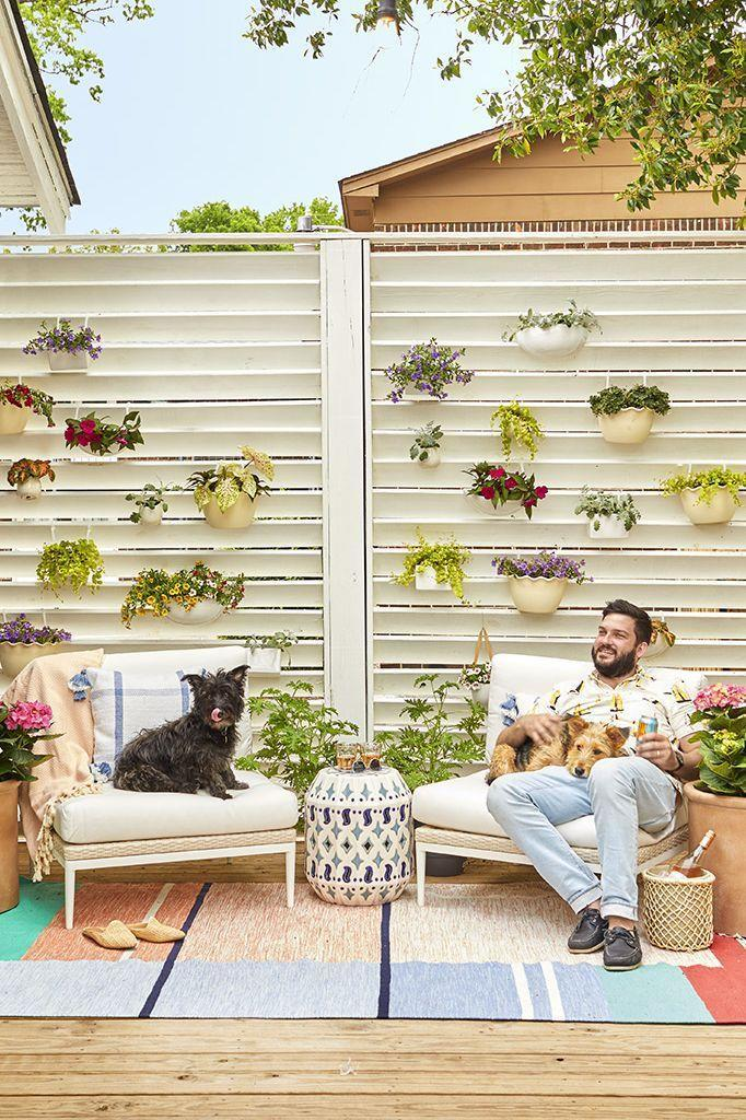 <p>Think of floating plants as a gallery wall for the outdoors. Attach flat-backed planters to the slats using zip ties or small hooks, and then fill 'em with an array of colorful plants. </p>