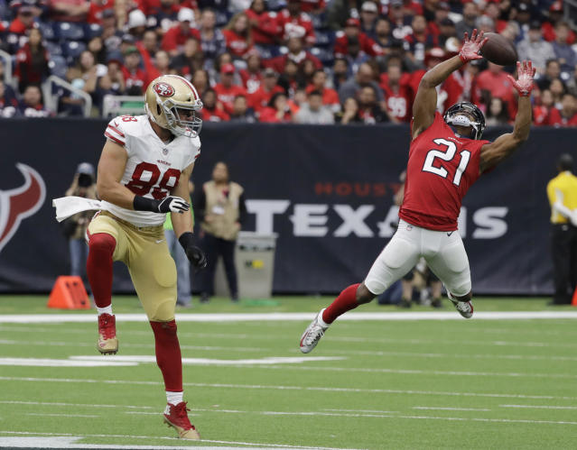 <p>Houston Texans strong safety Marcus Gilchrist (21) fails to intercept a pass intended for San Francisco 49ers tight end Garrett Celek (88) during the first half of an NFL football game, Sunday, Dec. 10, 2017, in Houston. (AP Photo/David J. Phillip) </p>